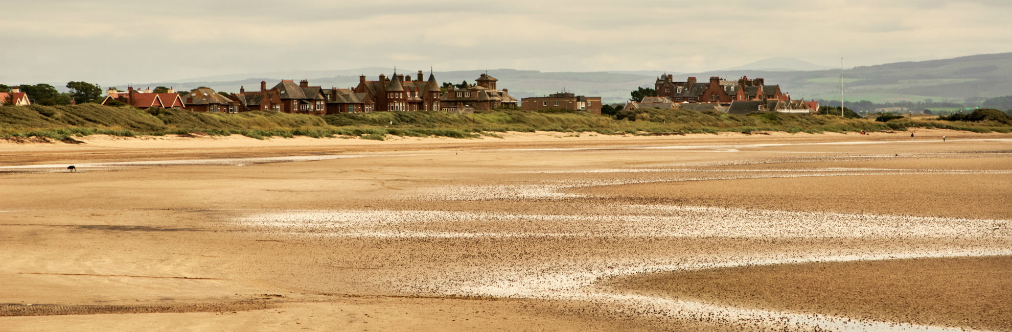 Looking over Troon's sandy beach towards the town of Troon in Scotland