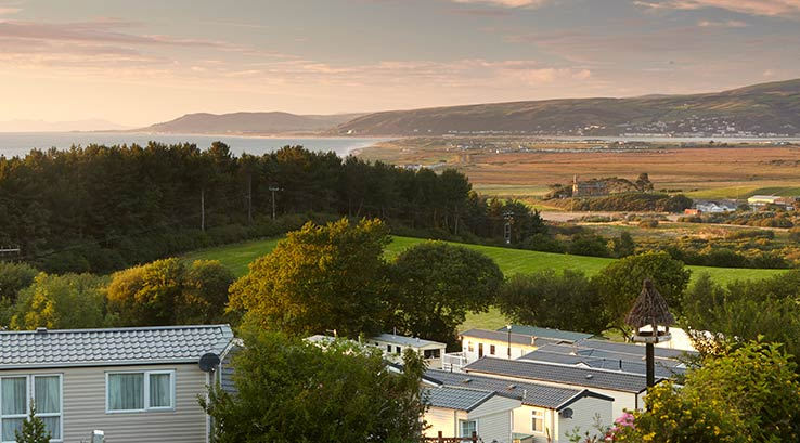 A spectacular sunset over Cardigan Bay in Wales, with Brynowen Holiday Park in the foreground