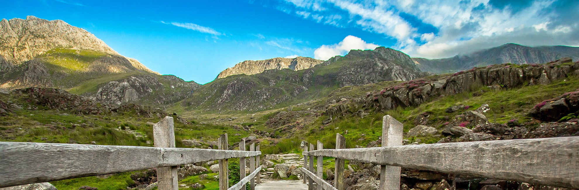 A footpath heading towards the impressive peaks of Snowdonia National Park