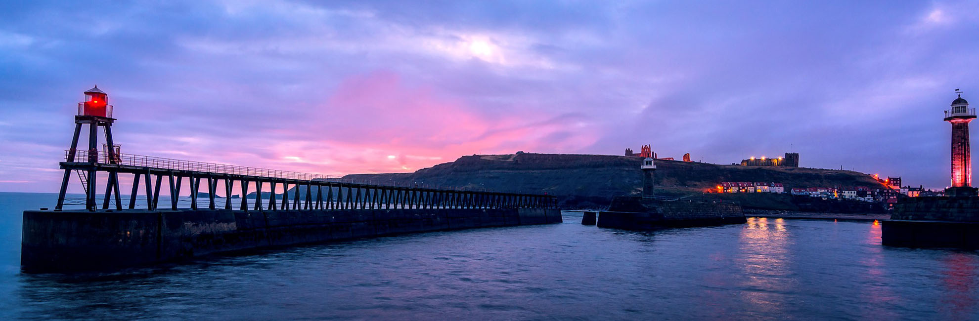 Piers across the sea at dusk in Yorkshire