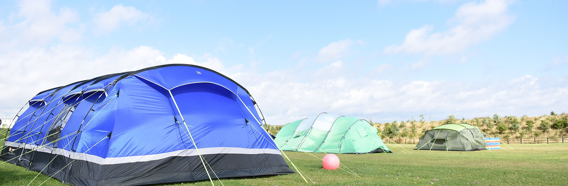 Tents pitched up on the grass