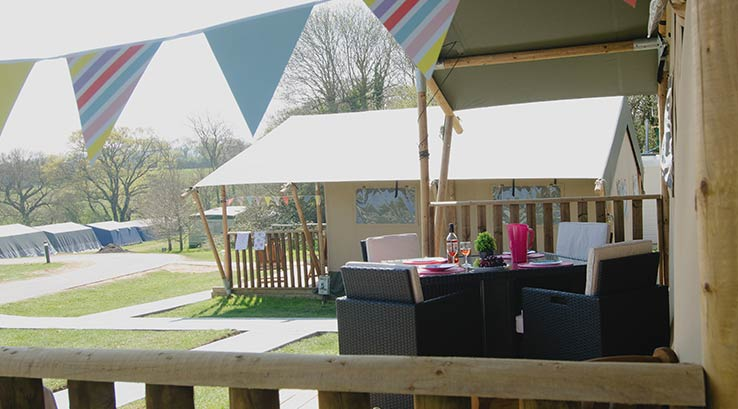 Safari tent porch with dining area