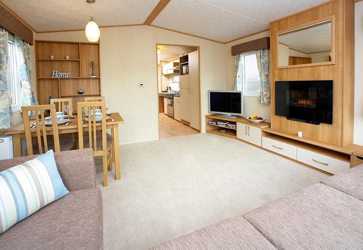 https://www.parkdeanresorts.co.uk/~/media/parkdean-resorts/units/dunraven-wfa_1310/lounge01.jpg