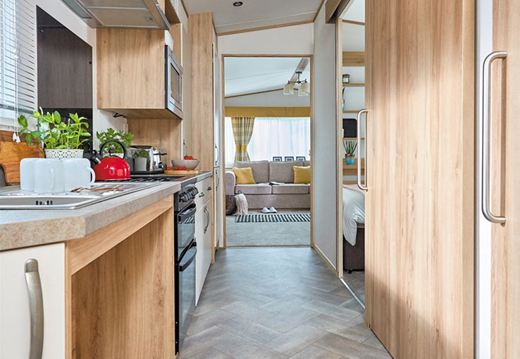 Brand new in 2018, this extra wide wheelchair friendly caravan has an access ramp, sliding internal doors and a wider corridor. Plus the spacious bathroom has hand rails next to the toilet and a seat in shower. There's double glazing, central heating and a flatscreen TV with Freeview.