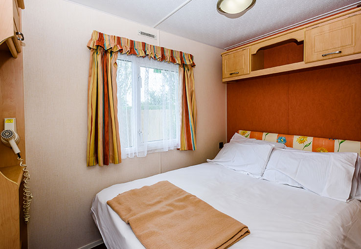 This homely caravan is heated throughout including a fire in the lounge to ensure everyone is comfortable on their holiday. There's a flat screen TV with Freeview and well equipped kitchen. It's ideal for a relaxing break.