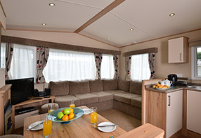 A caravan with double glazing and central heating so everyone stays cosy. Packed with home comforts including an appliance-packed kitchen. With space for up to six, thanks to additional sleeping in the lounge.