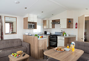 This superb caravan has double glazing and central heating, as well as an appliance packed kitchen. It's a great space for families, with additional sleeping in the lounge so it can accommodate up to six people.