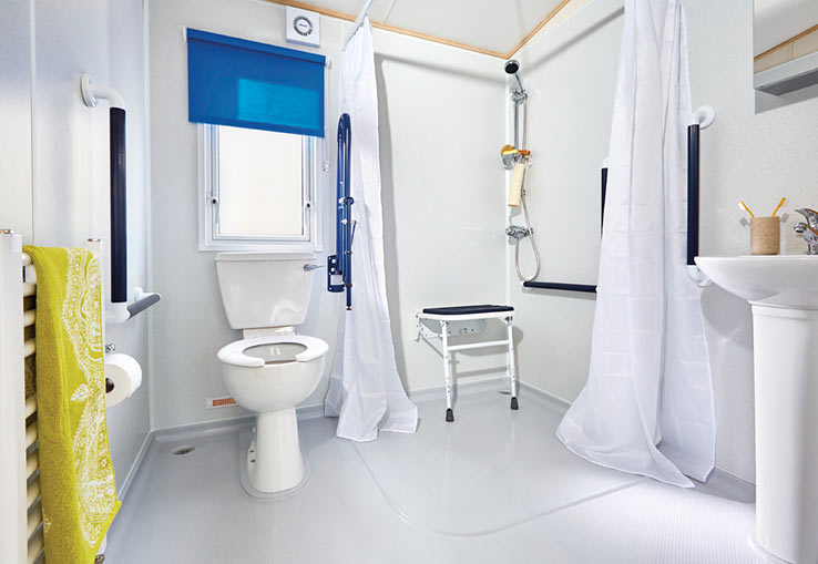 This has a contemporary feel. With a ramp, wider corridor, sliding doors and a large double bedroom that can become a twin. The bathroom has room to manoeuvre a wheelchair, rails next to toilet and a seat in the shower. Please be aware there is a small step into shower.