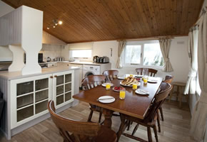 This lodge offers all the comforts of home including double glazing, central heating and has the luxury of a veranda with outdoor furniture for those sunny evenings. There's also an ensuite and separate toilet plus a well equipped kitchen with a washer dryer.