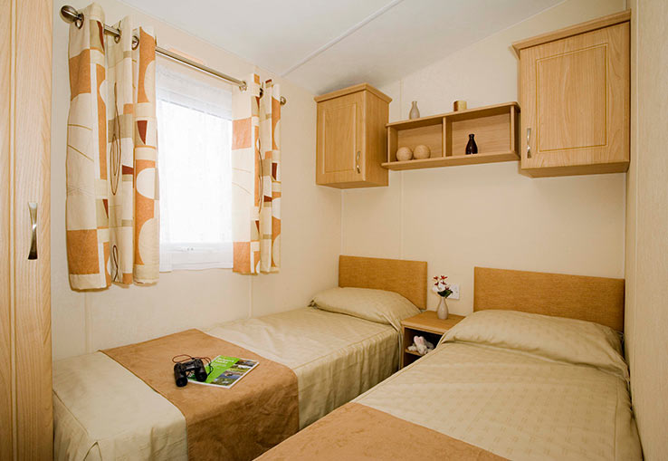 With four bedrooms this is our largest caravan with central heating and double glazing, you will find it's perfect for a family of eight. There's a flat screen TV with Freeview plus everything you need in the kitchen for cooking up great family meals, this caravan will make you feel right at home.