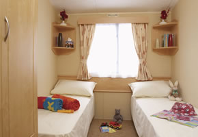This spacious two bed model has bags of room for couples and families. As well as a TV, there's  DVD player and a CD player. With double glazing and central heating it's cosy too.